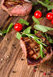 Delicious beef steaks on wooden planks