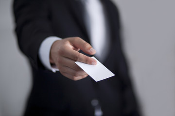 Businessman giving to someone blank business card