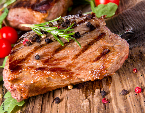 Delicious beef steak on wooden planks