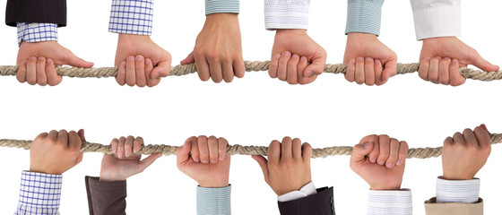 Hands holding rope, teamwork concept