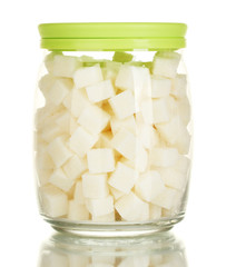 Jar with a white lump sugar isolated on white