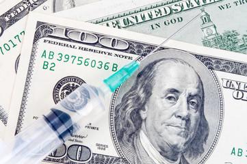 Syringe and Dollars