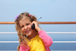 girl stands on board ship and says by portable radio phone