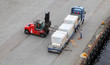Small auto-loader unload truck, labourer help, view from above