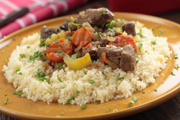 Lamb meat with vegetables and couscous