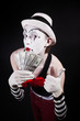 theatrical mime with dollars