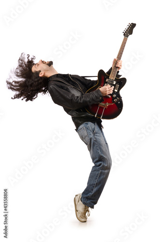 Young man playing guitar on white