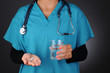 Nurse With Pills and Glass of Water