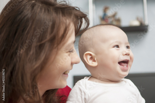 lovely portrait of mother together with son smiling