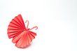 Origami Japanese red paper butterflies on white background.