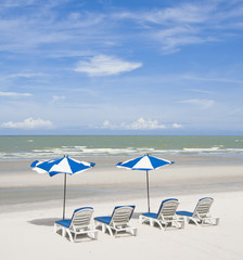 summer tropical beach with blue sky with umbrella and chair