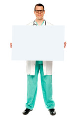 Male doctor displaying white advertising board