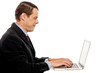 Side view of corporate male typing on laptop