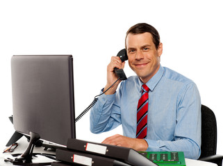 Businessman talking on phone, handling clients
