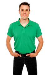 Smiling guy posing with hands in jeans pocket