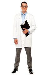 Full length shot of doctor posing with clipboard