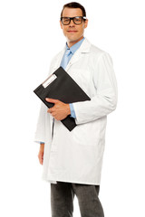 Doctor in glasses carrying clipboard