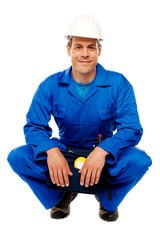 Smiling male worker wearing safety hat