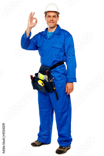 Construction worker gesturing okay sign