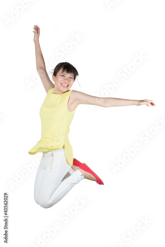 Happy woman jumping in air.