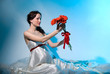 Pregnant woman holds flowers on outstretched arms