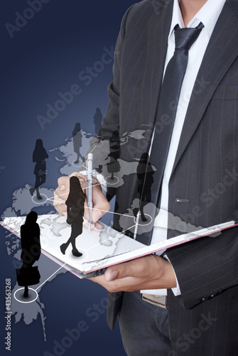 Businessman writing on notebook with Social Network.