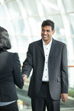 Asian business man shaking hands with a woman