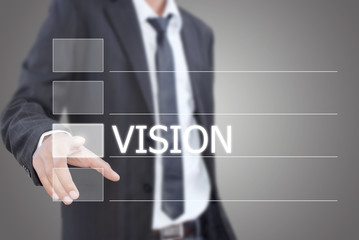 Businessman pushing Vision word on the whiteboard.