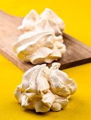Dry meringue homemade candies. on wood