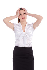 Worried business woman holding head in frustration over white