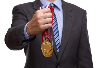 Businessman holding gold medal
