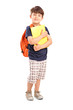 School boy with backpack holding a notebook