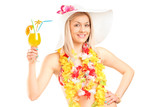 Portrait of a female dressed in a hawaiian costume holding a coc