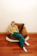 Man sitting on the couch reading book