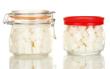 Jar and sugar-bowl with white lump sugar isolated on white