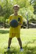 Little boy holding a basketball