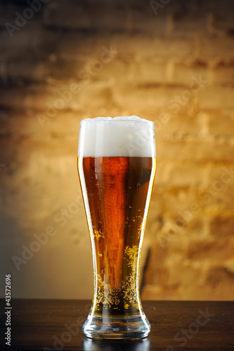 Glass of beer against a stone wall