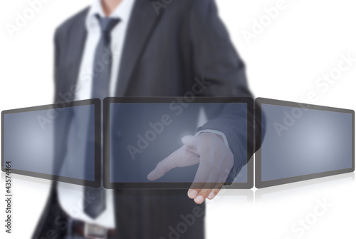 Businessman pushing on tablet screen.