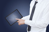 businessman pushing tablet screen in hand..