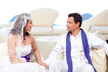 Couple in wedding day relaxed in white terrace