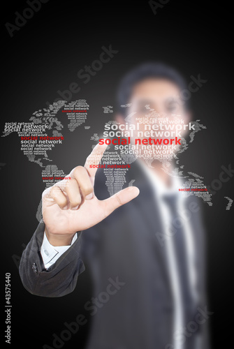 Businessman pushing Social Network world map.