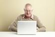 Senior using laptop