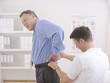 Physiotherapy: Physiotherapist examining senior man