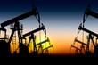 Leinwanddruck Bild - silhouette oil pumps