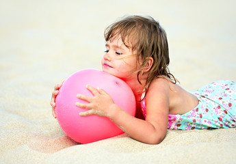 Girl plays with a ball