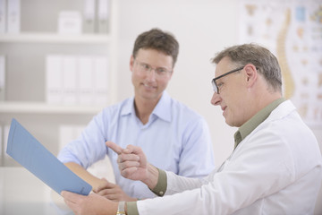 Doctor and patient discussing blood-test results