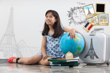 Girl thinking travel around the world, education concept