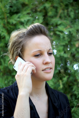 Young Attractive Businesswoman On the Phone