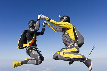 Girls parachutist in free fall.