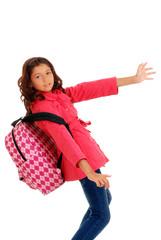 School girl struggling heavy backpack
